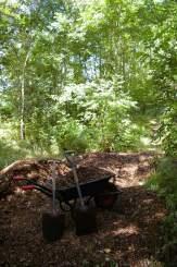 Wheelbarrow, woodchip and shovels