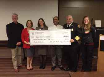 Alex Rhoten, Mary Louise VanNatta, Alison Kelley, Dr. Rhagu Kamineni, Chief Mike Niblock and Heidi Conklin pictures with check from Salem Health to SFF