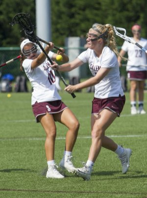LAX Alla Daniel_left_and Libby Bowman coverge to get control of loose ball
