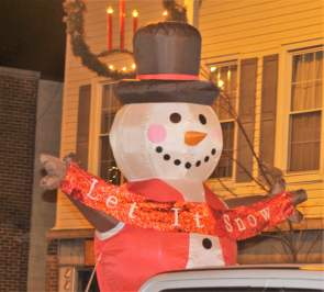 Residents and visitors braved cold temperatures to see Santa and other floats.