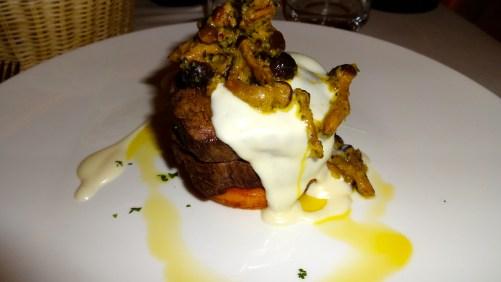 Beef Tenderloin with Porcini Mushrooms, Taleggio Cheese Sauce, and Potato and Black Truffle Pie.