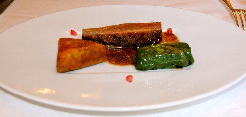 Roasted Duck with Swiss Chard and Greek Olive Pastilla.