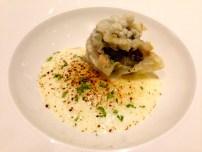Tempura Artichokes stuffed with Taleggio Cheese with Potato Foam and Licorice Powder.