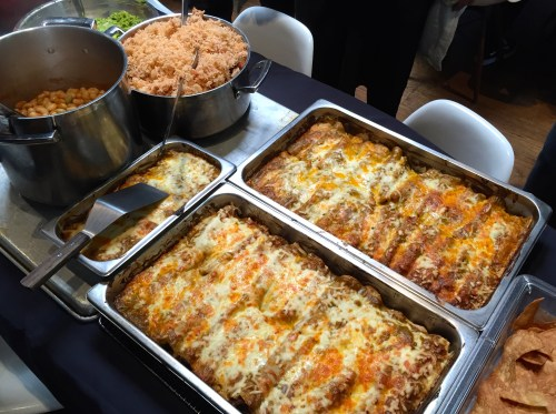Enchiladas, Rice, Beans, and Guacamole.