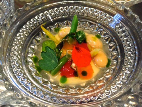 Summer Minestrone with Parmigiano Reggiano Cheese Custard, Various Summer Vegetables, and Tomato Water.
