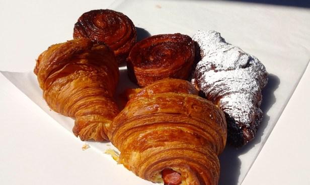 Kouign Amann (9/10), Almond Croissant (9/10), Plain Croissant (8/10), and Ham and Cheese Croissant (8.5/10).