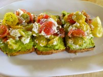 Avocado Toast with Goat Cheese and Tomatoes.