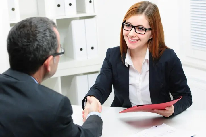salesperson-shaking-hands-after-successful-interview