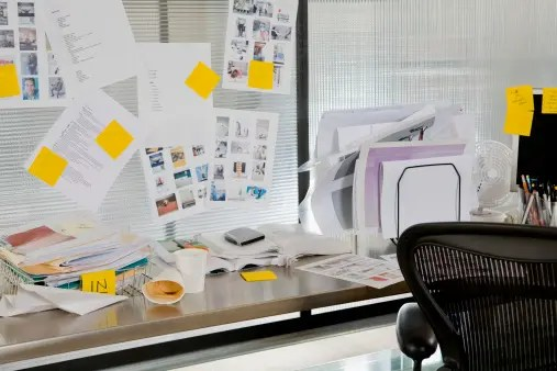 Cluttered sales rep's desk