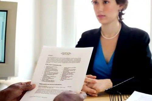 manager reviewing resume for financial sales advisor