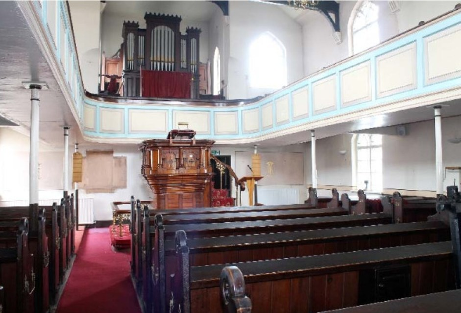 The church interior with pipe organ