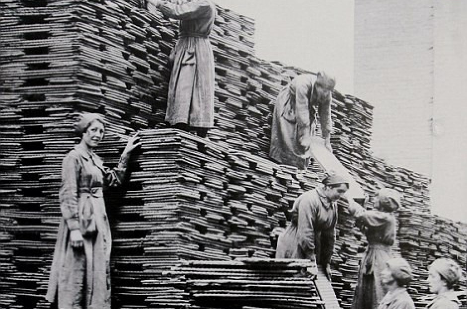 Women pile high stacks of oil and cake feed for industry - © Imperial War Museum