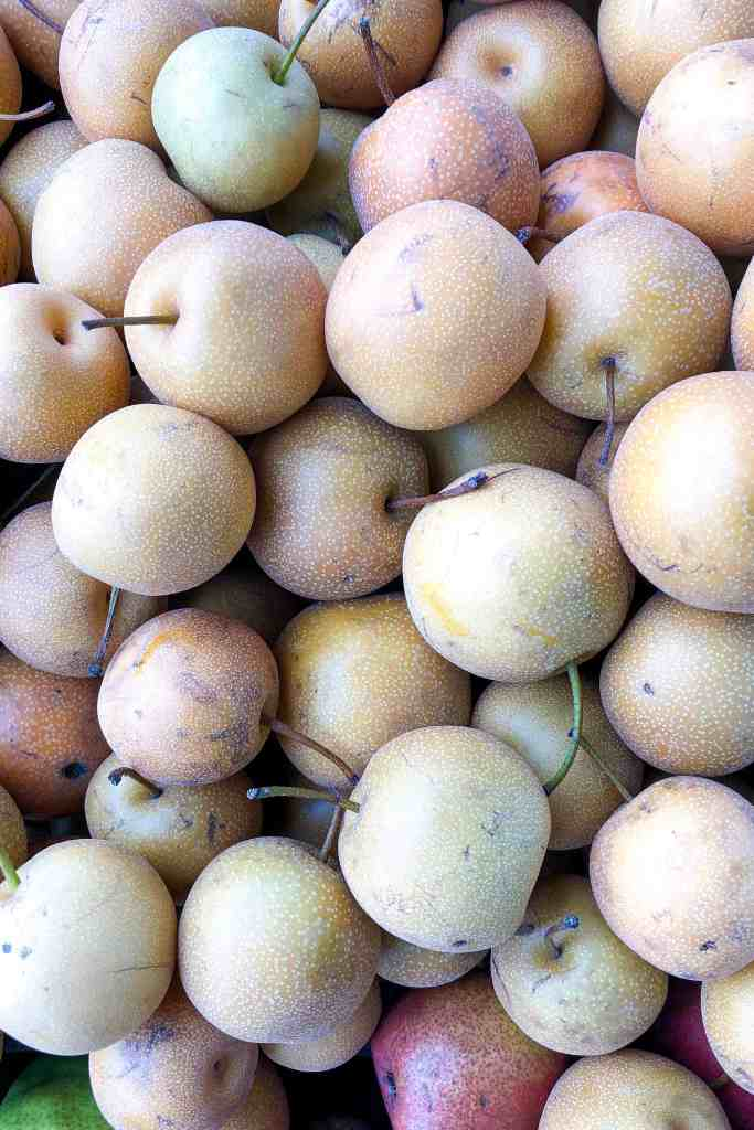 A basket of asian pears.
