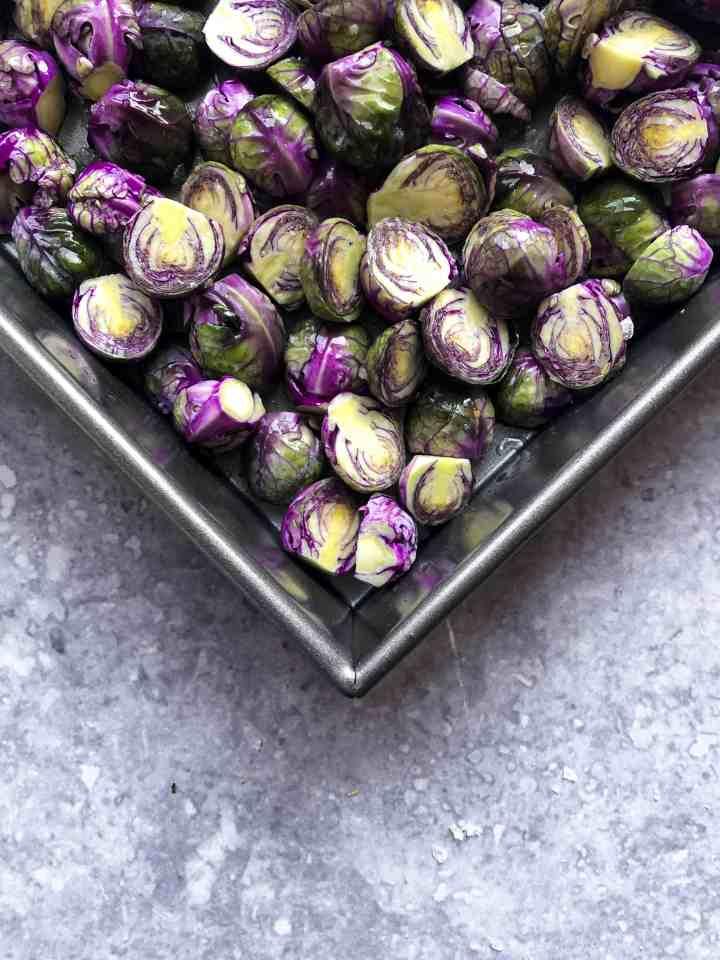 Purple lemon dijon brussels sprouts in a pan.