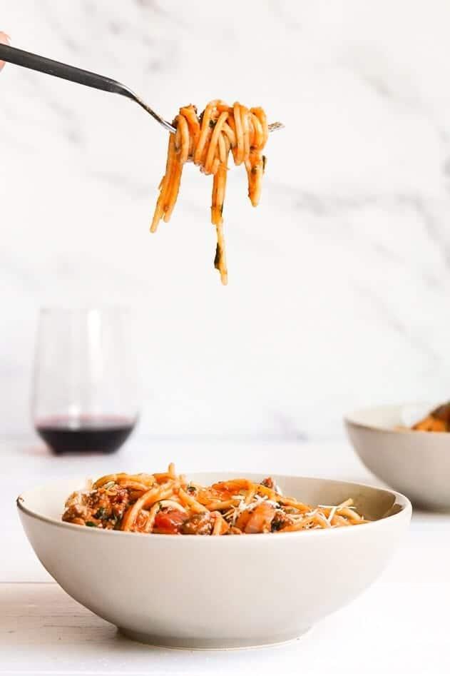 Gluten free quarantine friendly weeknight spaghetti twirling on a spoon.
