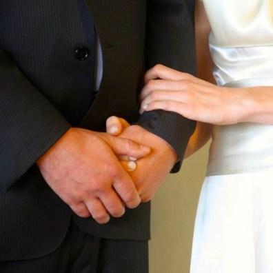 hands of groom & bride
