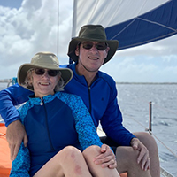 Bill Dietrich on a sailboat with his wife, Holly.