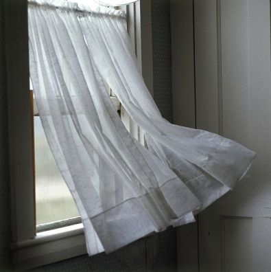 Curtains blown by the wind
