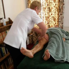 Sally using friction on a clients thighs.