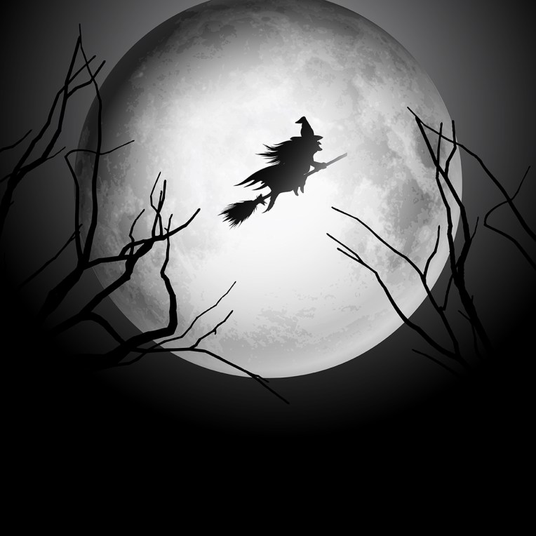 Halloween background with witch flying in the sky