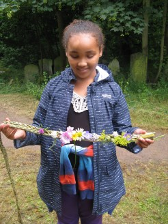 child with flower decorated plait