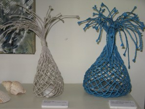 two open weave paper string sculptures