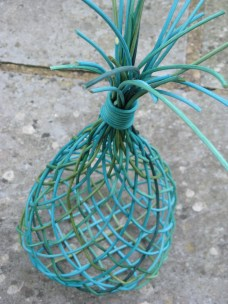 Open weave dyed cane basket