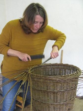 Karen Lawrence doing border of log basket