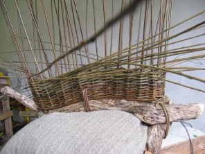 French randing on side of 'boat' basket