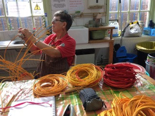 Sally Roach working on cane sculpture