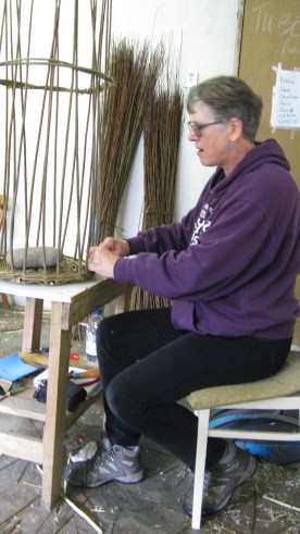 Sally Roach making a willow log basket