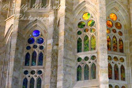Basilica de la Sagrada Familia Barcelona Spain Apse Facade stained glass windows blue green orange colours