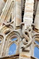 Close up of a snake sculpture on the apse of the Basilica de la Sagrada Familia, Barcelona Spain