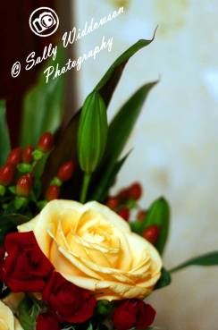 Miniature red roses large cream ivory rose bouquet red berries lily bud lilly