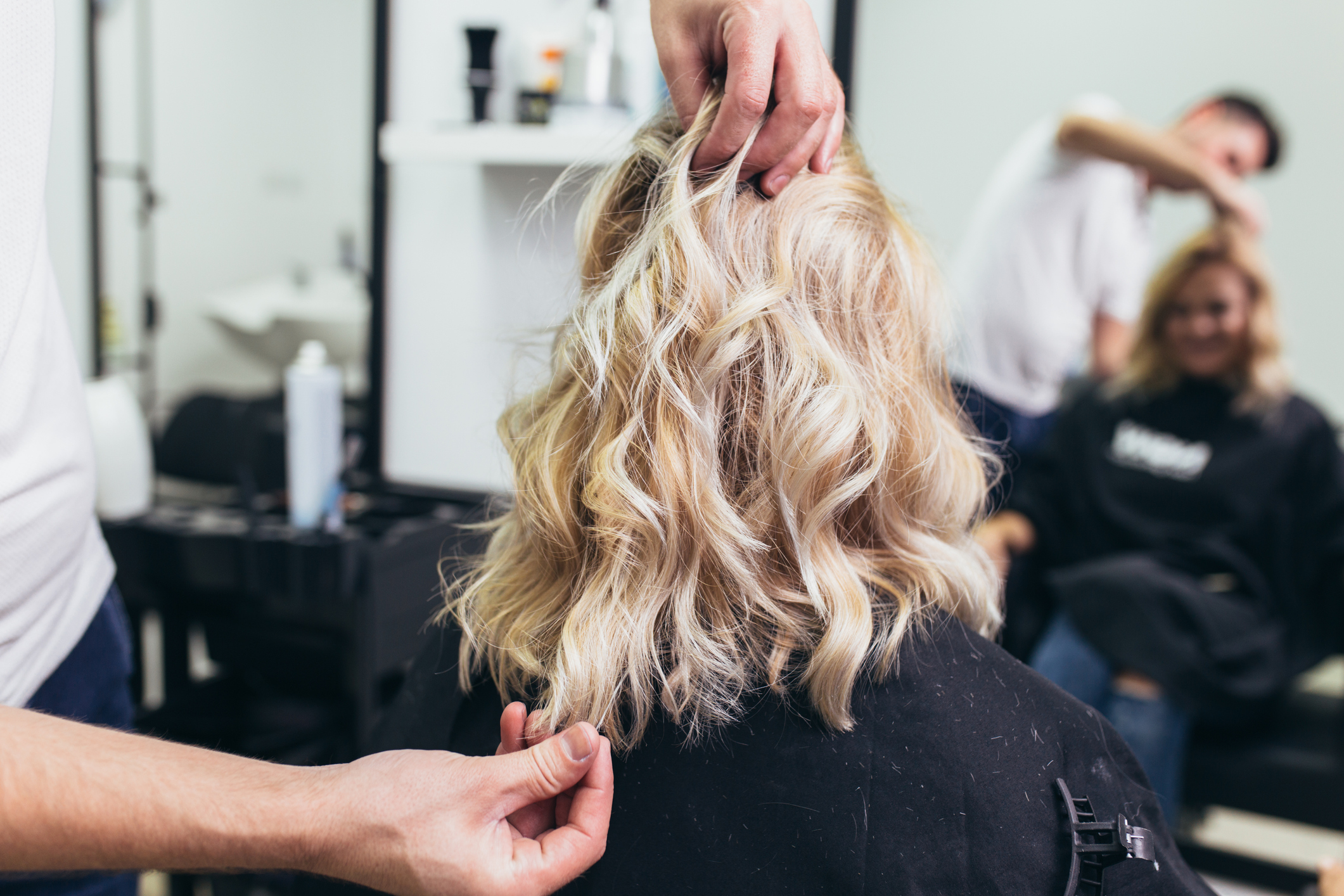 Close-up of a woman in hair salon, adding luxurious hair for women with hair loss.