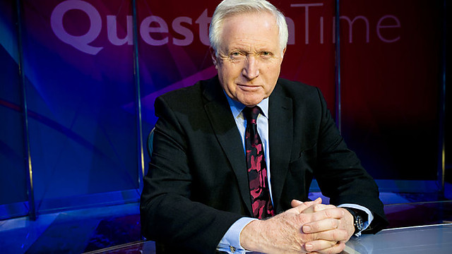BBC Question Time - David Dimbley behind desk - looking sardonic