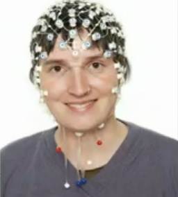 headshot of woman wearing the headset