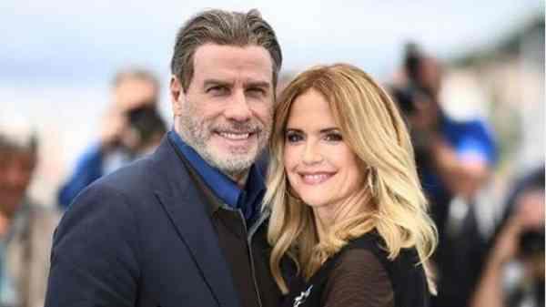 John Travolta y su esposa