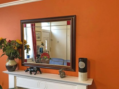 Lovely large mirror with leaded stained glass details.