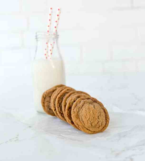 Gingersnap cookies and a glass of milk.