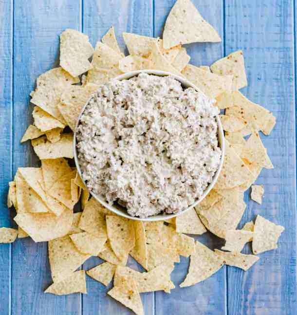 Cream Cheese Sausage Dip centered with tortilla chips surrounding the dip bowl.
