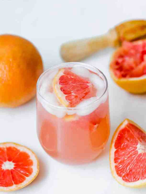 Grapefruit Italian Soda with a grapefruit wedge in the drink.