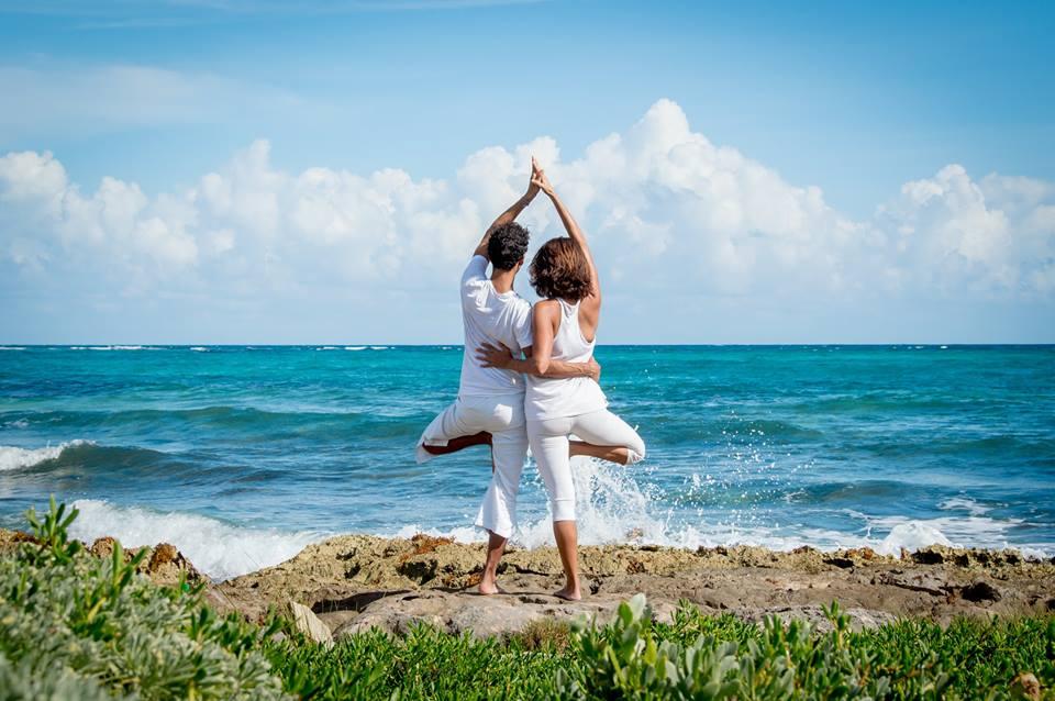 yoga couple on the beach