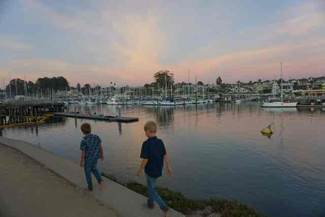 The harbor at sunset looking across at the Crow's Nest Restaurant in Santa Cruz, CA