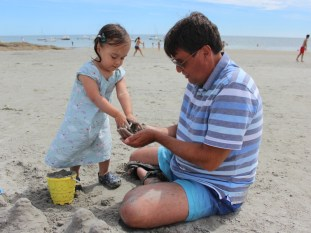 Building sandcastles with grandad