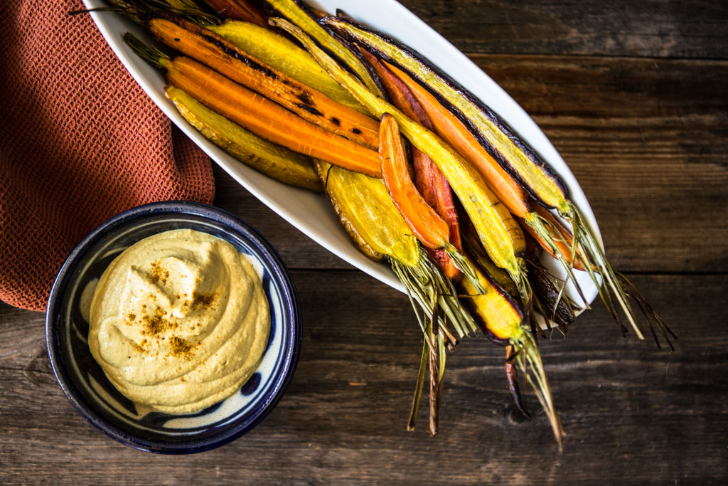 Whole30 compatible creamy curry cashew dip and roasted rainbow carrots..