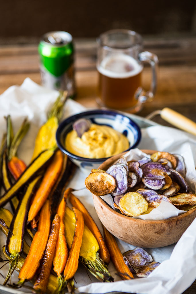 Creamy Curry Cashew Dip with chips and roasted carrots.