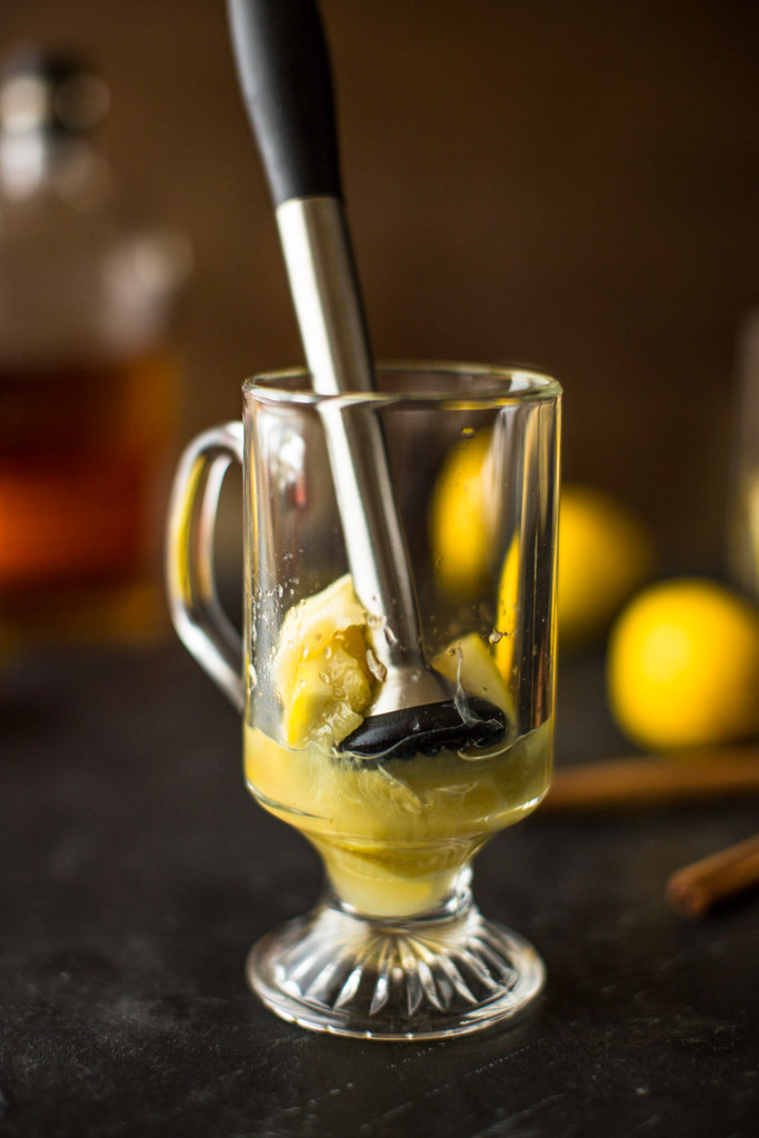 Muddled lemons and maple syrup make this Muddled Maple Hot Toddy a favorite winter cocktail.