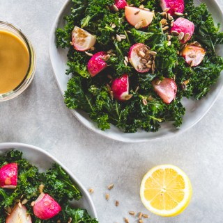 Combine massaged kale, roasted radishes, and toasted sunflower seeds for a hearty salad that's both nourishing and delicious.