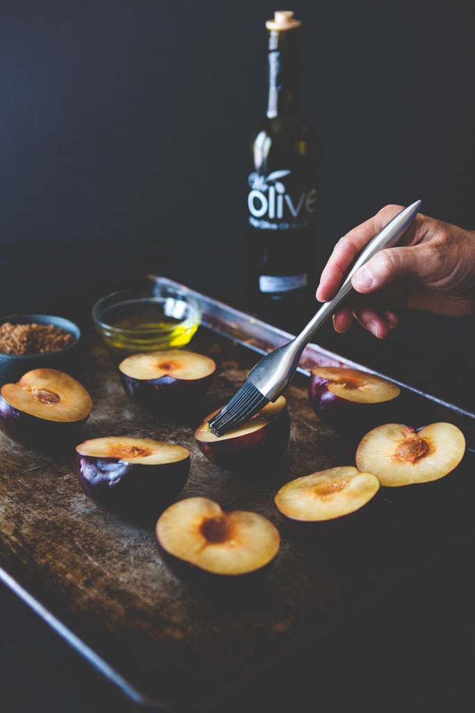 Brush plums with good quality olive oil to boos their roasting potential and help caramelize the sugar.